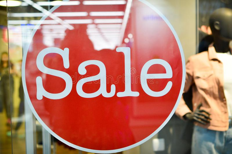 Signboard with the inscription Sale in the fashion store. Sale, discounts. Image of a sale ad in a clothing store window. Signboard with the inscription Sale 50 stock photography