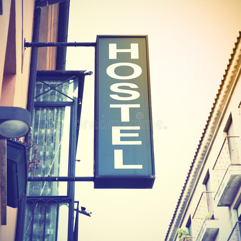 Signboard od hostel. Retro style filtred image royalty free stock photography