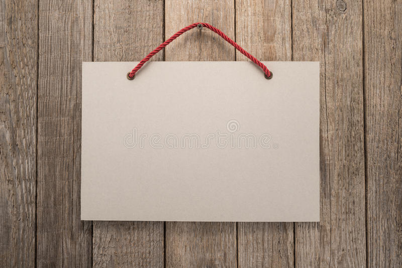 Signboard with rope. On wooden background stock photos
