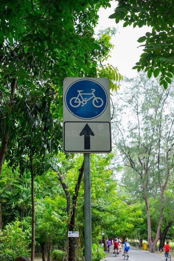 Signboard shows bicycle lane this way royalty free stock image