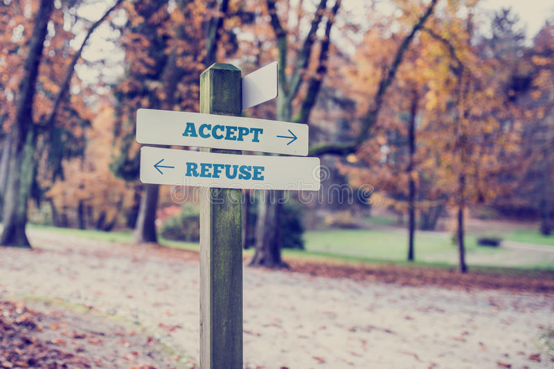 Signboard with two signs saying - Accept - Refuse. Rural signboard with two signs saying - Accept - Refuse - pointing in opposite directions with a vintage style royalty free stock photos