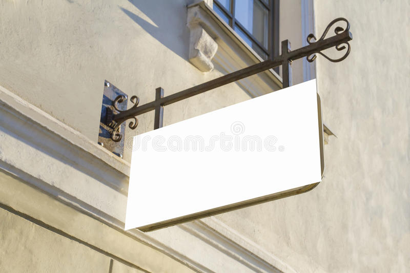 Signboard on the wall. Mock up. Rectangular shape. Oldtown view royalty free stock photography
