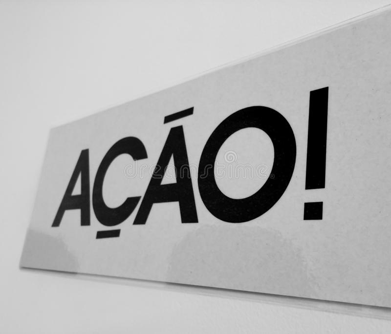 Signboard with the word action in Portuguese ação! royalty free stock images