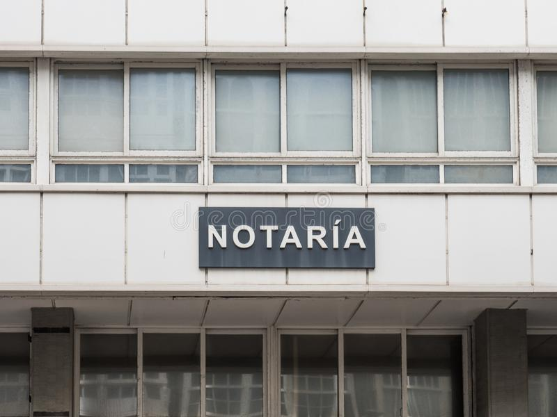 Signboard with the word notary in Spanish stock photography
