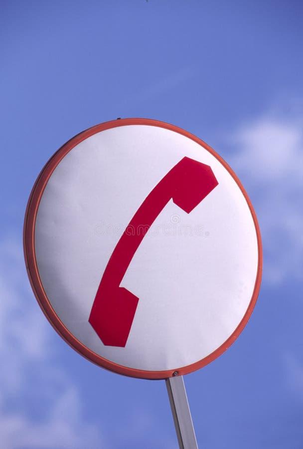 Signe avec le téléphone rouge photos stock