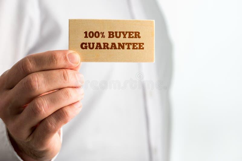 Signe avec les textes 100% de garantie d'acheteur images libres de droits