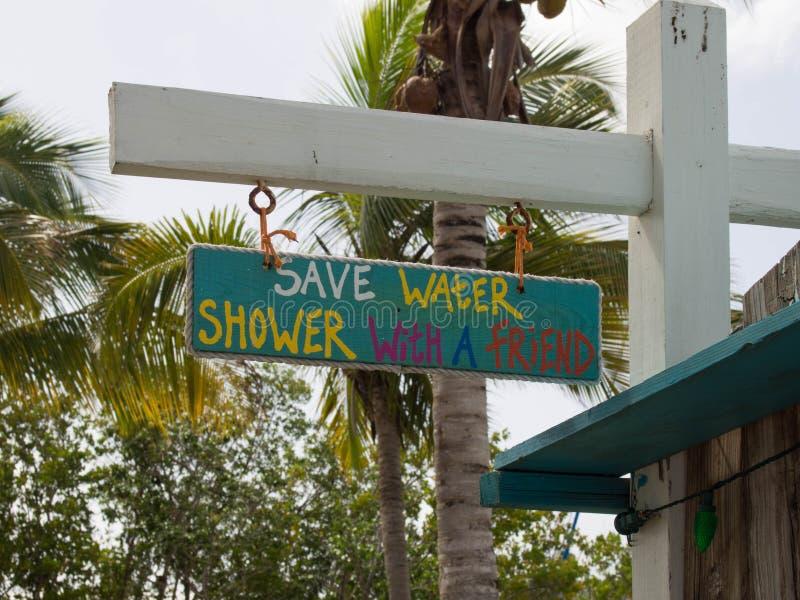 Signe décoratif - douche de l'eau d'économies avec un ami image stock