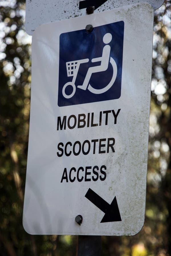 Signe d'accès de scooter de mobilité photos stock