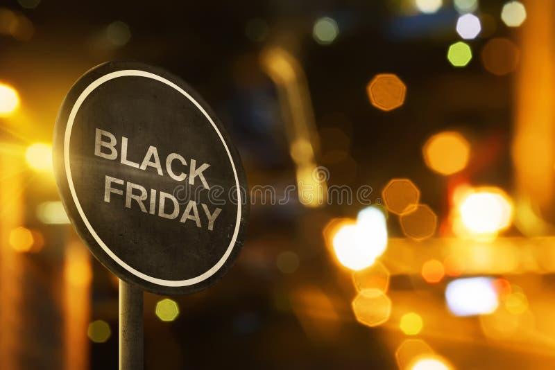 Signe de Black Friday avec l'éclairage de tache floue photographie stock libre de droits
