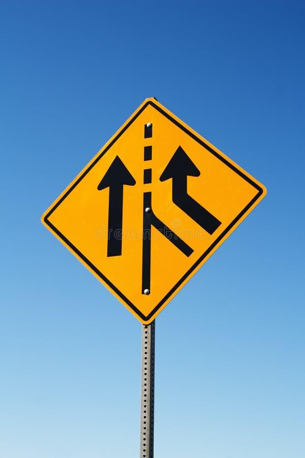 Signe de fusion du trafic image stock