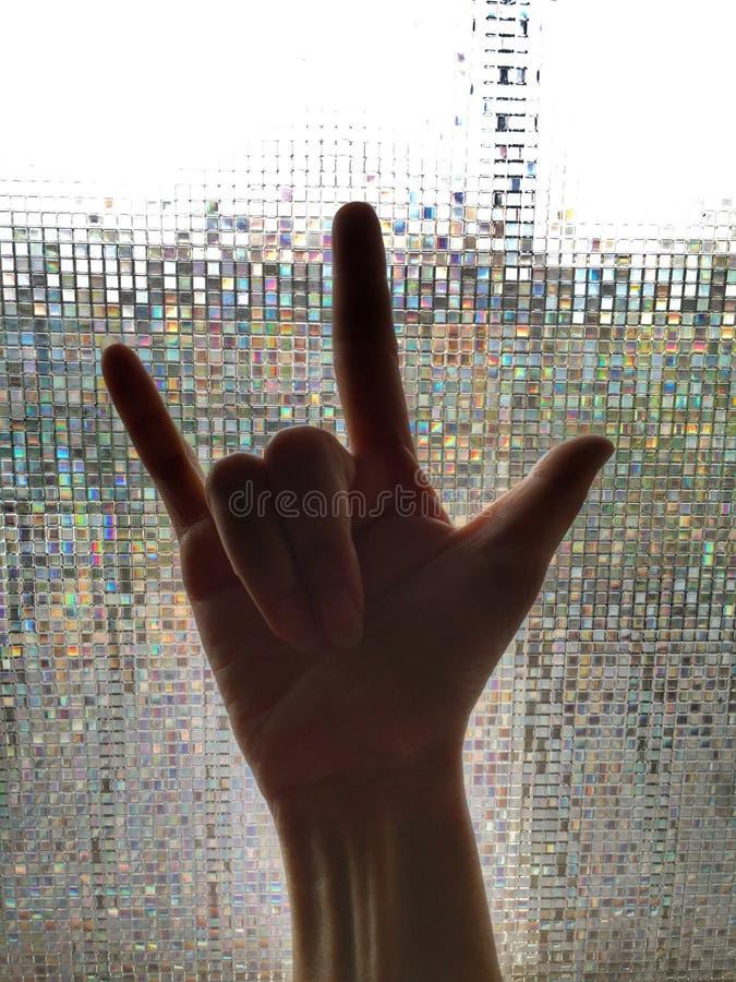 Signe de main avec la femme de main image stock