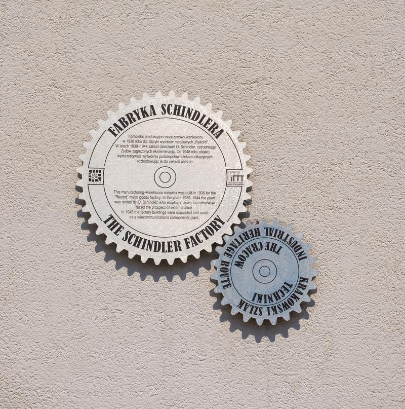 Signe de mur en dehors d'usine de Schindler photographie stock