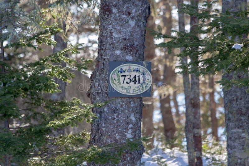 Signe de numéro de maison photographie stock libre de droits