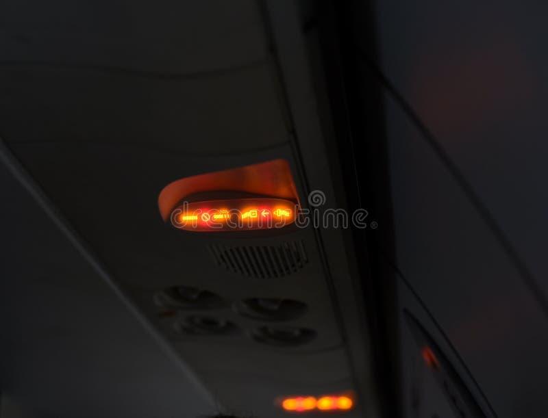 Signe de sécurité d'une photographie courante de passagers d'avion images stock