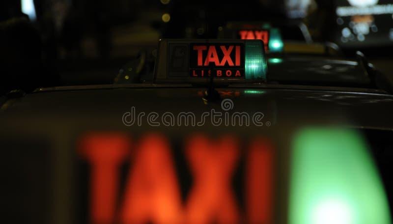 Signe de taxi de taxi photographie stock