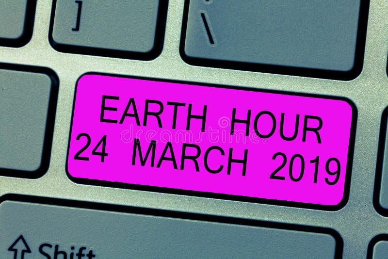 Signe des textes montrant l'heure de la terre le 24 mars 2019 La photo conceptuelle célèbrent des économies de durabilité que la  images stock