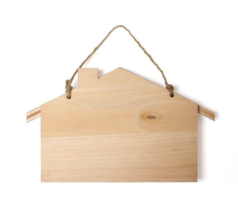 Signe en bois accrochant d'isolement image stock