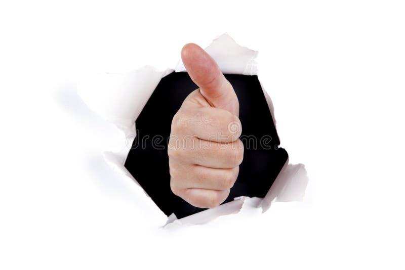 Signe en bon état de main par le trou de mur photos stock