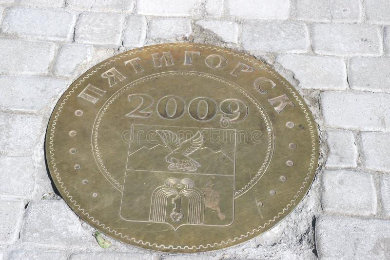 Signe en bronze, jour de la ville images stock