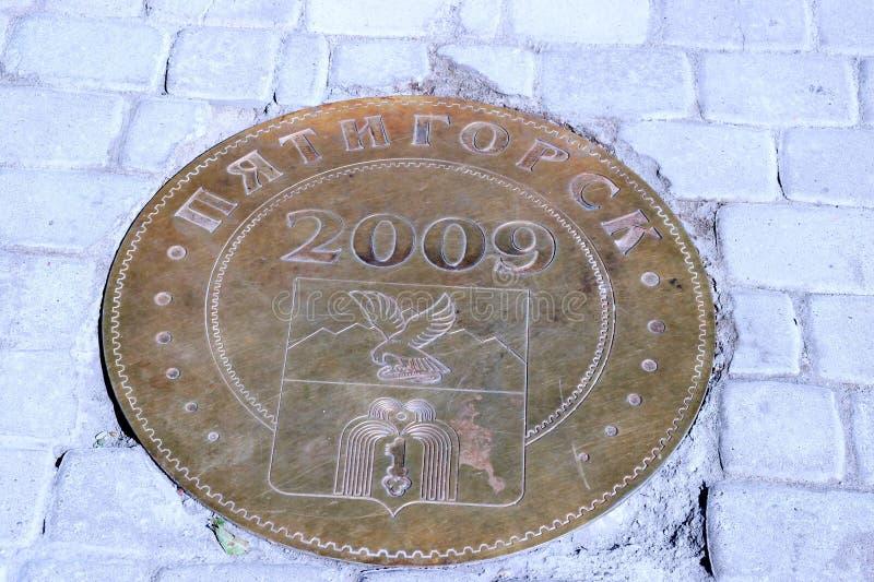 Signe en bronze, jour de la ville image libre de droits