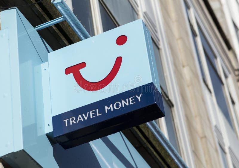 Signe et logo d'échange de TUI Travel Agents et d'argent photographie stock libre de droits