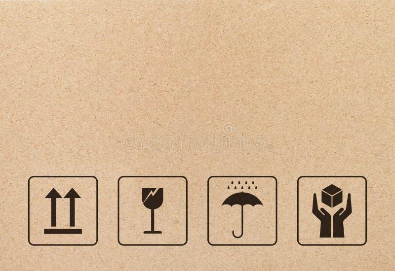Signe et symbole fragiles noirs sur le papier brun de carton illustration de vecteur