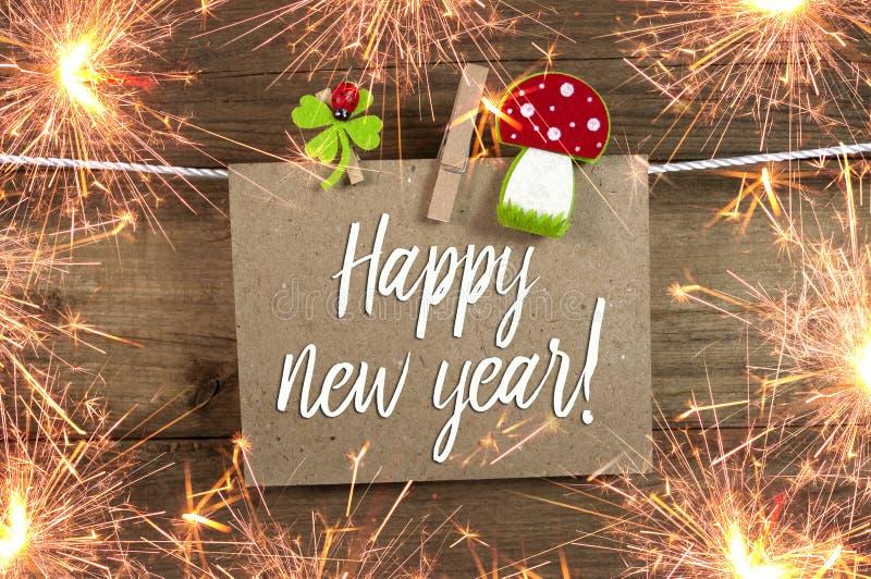Signe et tableau de label avec de nouvelles années Ève de bonne année avec 2019 et oxalide petite oseille photographie stock