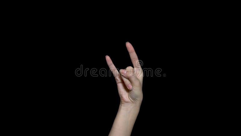 Signe femelle de petit pain d'anf de roche d'apparence de main ou trois doigts devant le fond noir les doigts de main montrent la images libres de droits