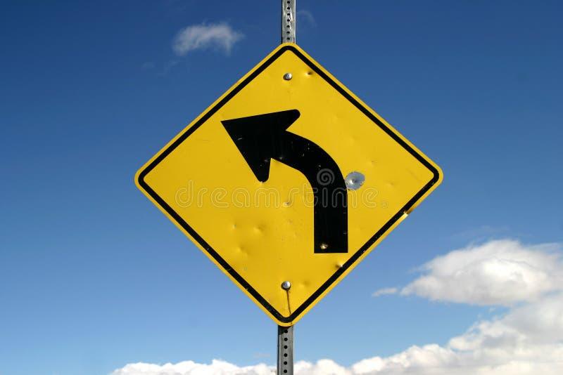 Signe pointu de virage à gauche photo libre de droits