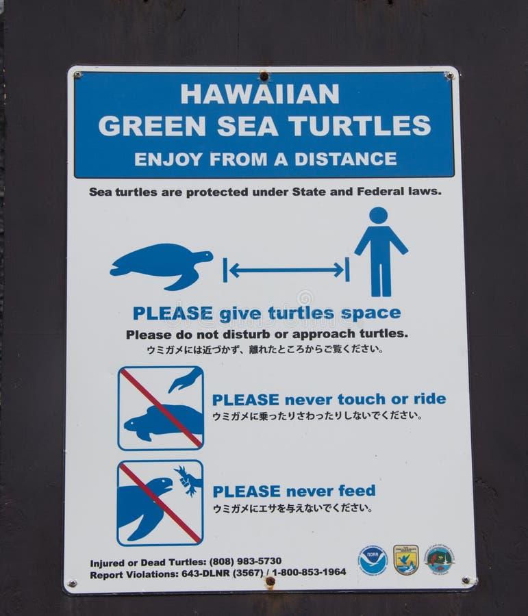 Signe pour des tortues de mer verte en Hawaï photos libres de droits