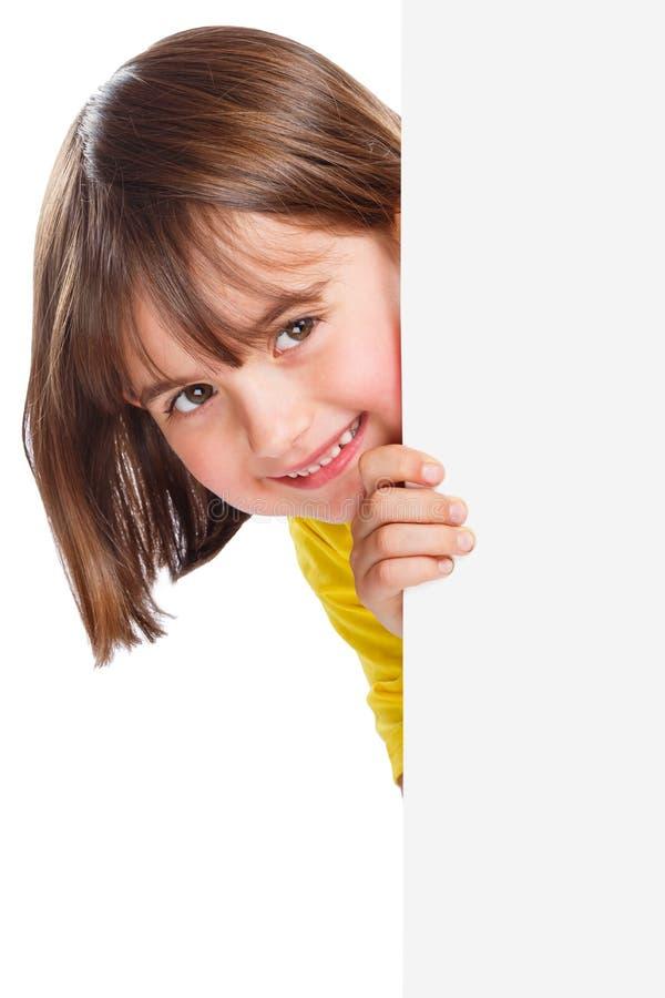 Signe vide vide de sourire de jeune de petite fille d'enfant d'enfant de copyspace annonce de vente d'isolement photographie stock