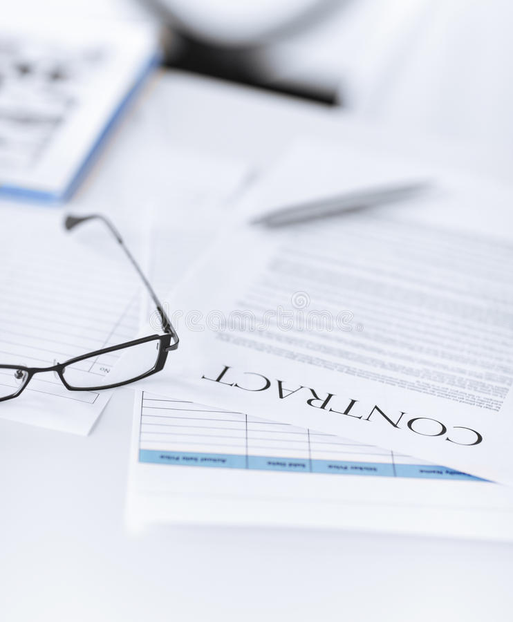 Download Signed Contract Paper With Glasses Stock Photo - Image of official, deal: 32480620