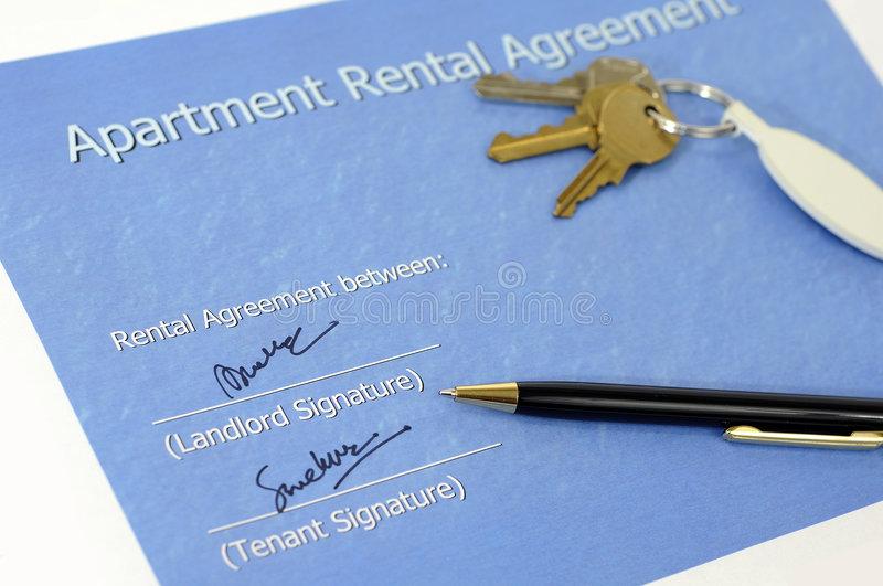 Signed rental agreement. Cover sheet of a printed property rental agreement document with the keys in the background royalty free stock images