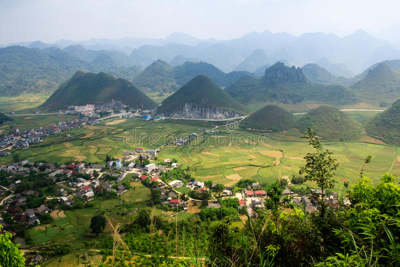 Significant mountain couple named `Nui Doi`, Quan Ba, Ha Giang, Vietnam. Its shape is the same as `Two Breasts` of the girl, lie in the middle of the field in royalty free stock photo