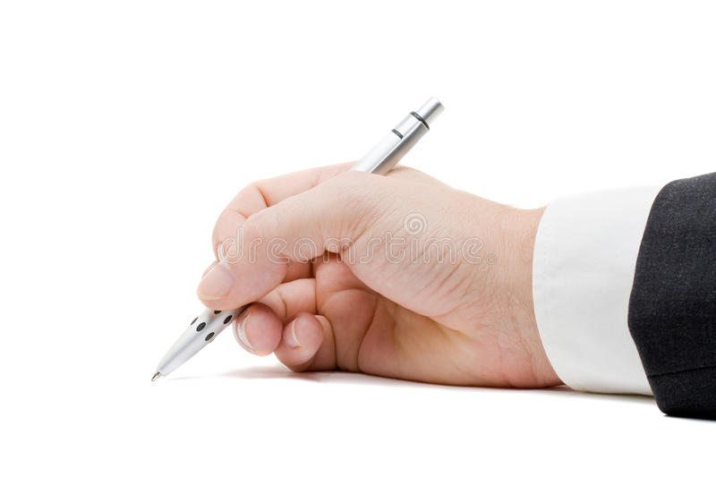 Signing. Close up of business mans hand signing paperwork with pen stock image