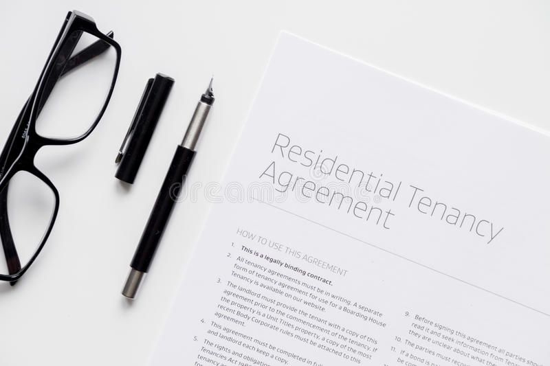 Signing of agreement top view on white background.  stock photography