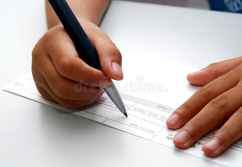 Signing check stock image
