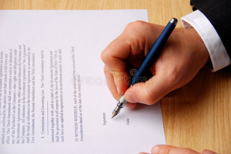 Signing contract royalty free stock photos