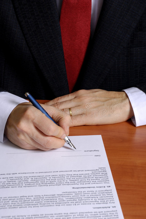 Signing a contract stock photography