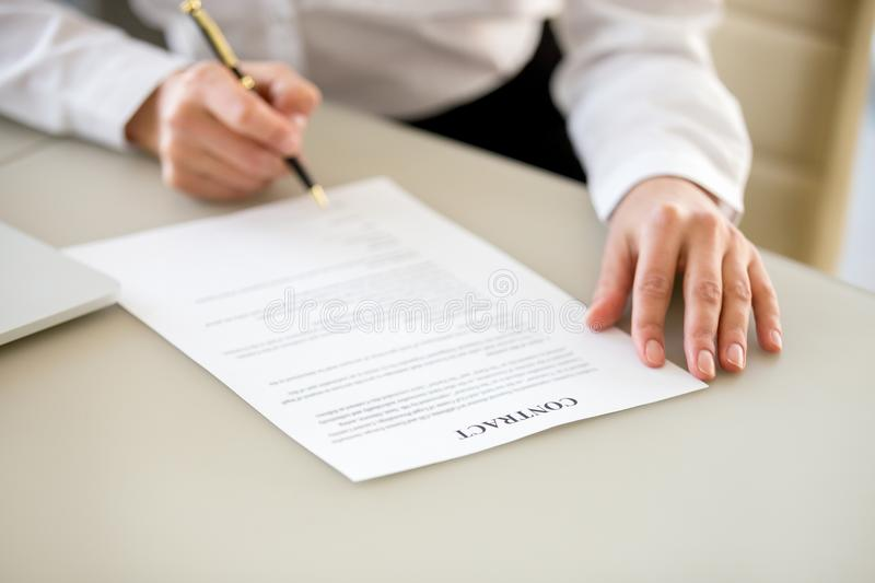 Signing contract concept, closeup of female hand putting written stock images
