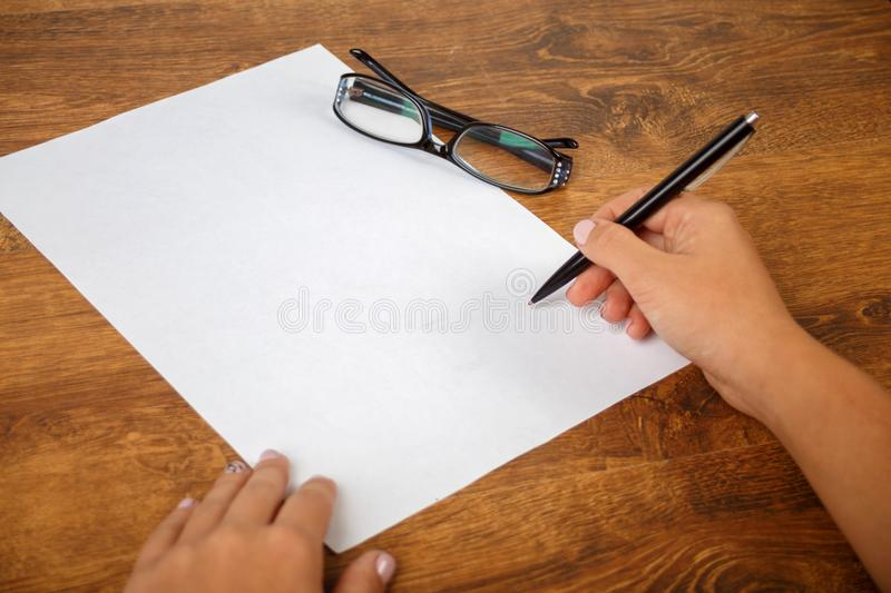 Signing a contract or document, writing an essay royalty free stock photo