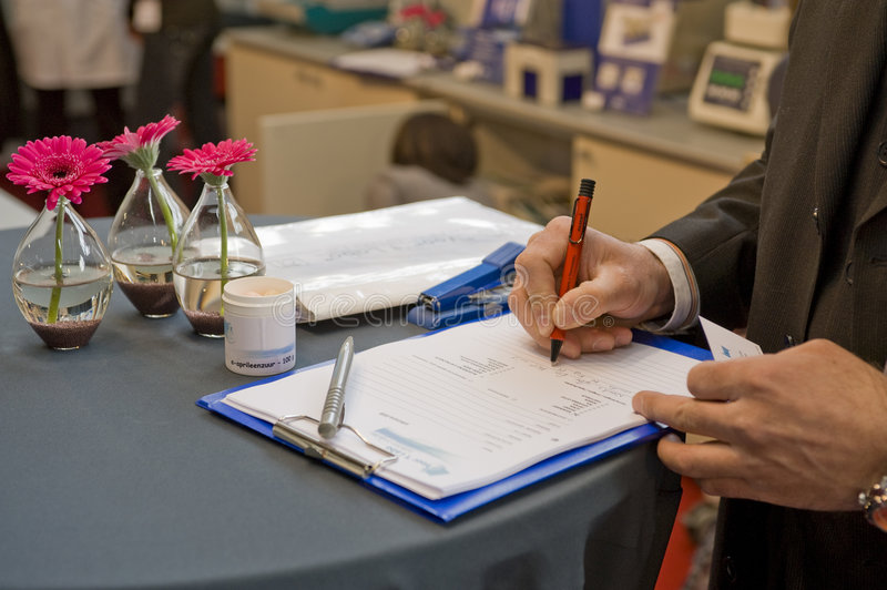 Signing a contract on a fair stock image