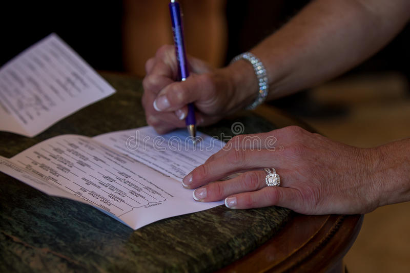 Signing the contract. Making the agreement official by signing the contract. Nice rings and diamonds royalty free stock photo