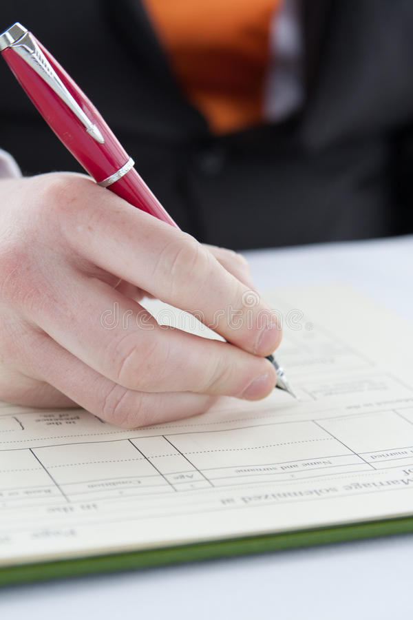 signing contract with red pen royalty free stock photos