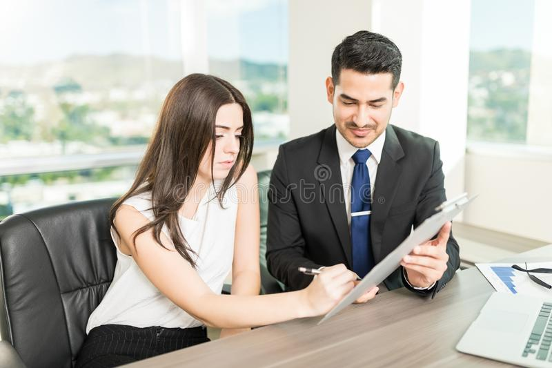 Signing Contract To Build Better Business Relationships royalty free stock image