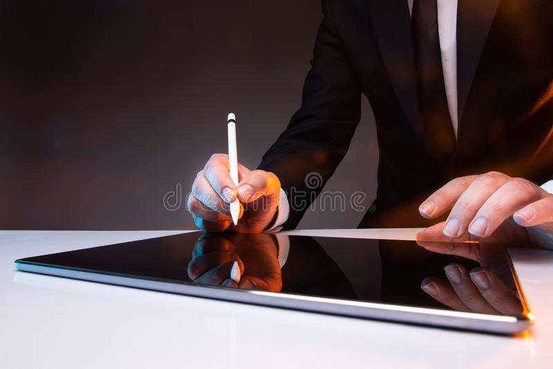 Signing Digital Contract On Digital Tablet royalty free stock images
