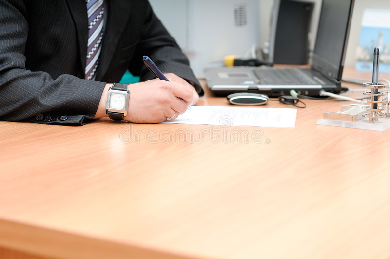 Signing the document royalty free stock photo