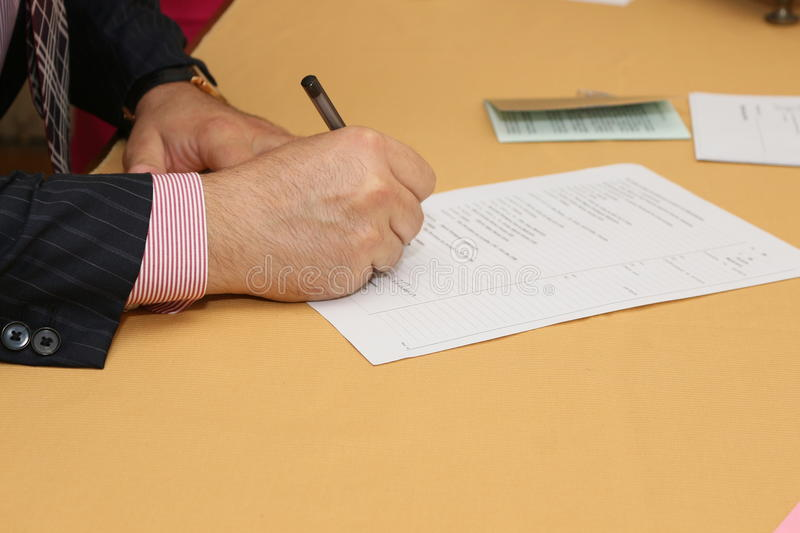 Signing document. A business man signing document royalty free stock photos