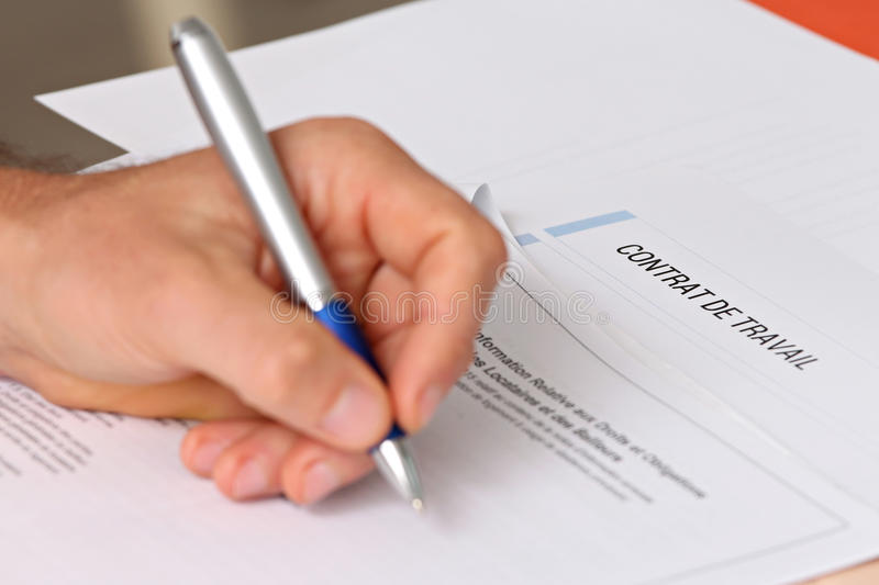 Signing a French employment contract stock photo
