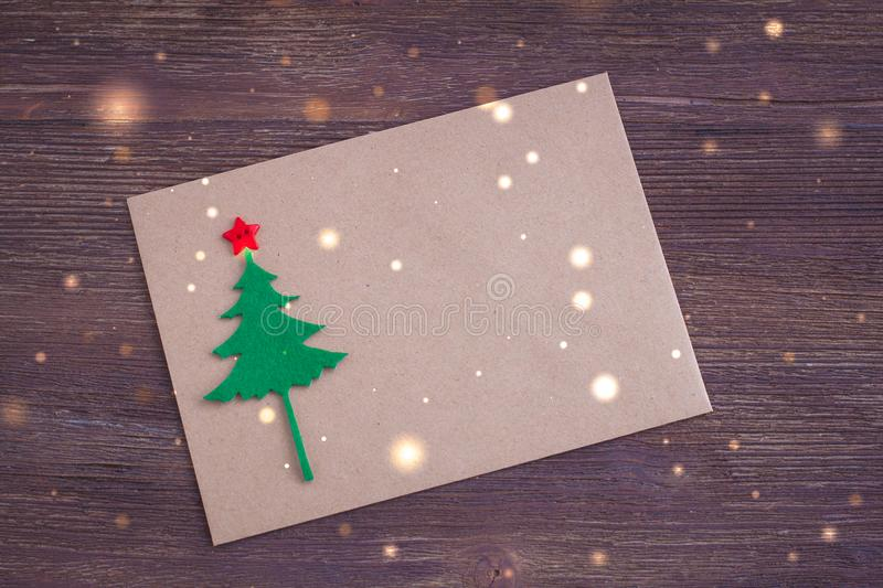 Signing handmade Christmas card with felt Christmas-tree, snowflakes effect and red star stock photos